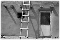 Ladder on adobe facade. Taos, New Mexico, USA ( black and white)