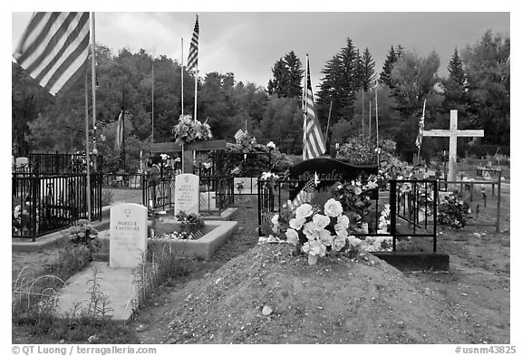 Headstones, tombs and american flags. Taos, New Mexico, USA (black and white)