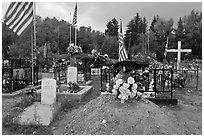 Headstones, tombs and american flags. Taos, New Mexico, USA ( black and white)
