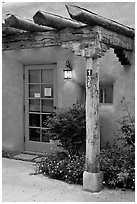 Blue door and window at house entrance. Taos, New Mexico, USA ( black and white)