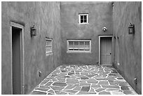 Courtyard and adobe walls. Taos, New Mexico, USA (black and white)