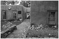 Front yard and pueblo style houses. Taos, New Mexico, USA ( black and white)