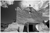 Facade of church covered with tightly compacted earth, clay, and straw, Picuris Pueblo. New Mexico, USA ( black and white)