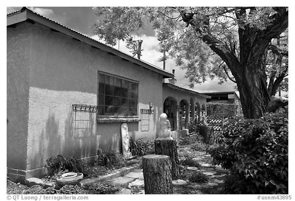 Gallery with sculptures in front yard, Truchas. New Mexico, USA (black and white)