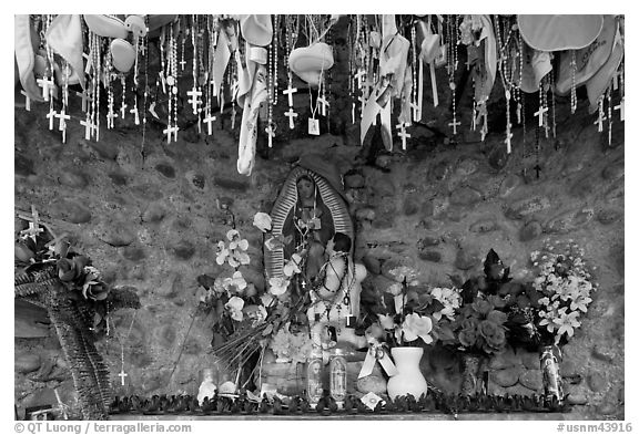 Niche with popular worship objects, Sanctuario de Chimayo. New Mexico, USA (black and white)