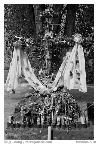 Cross festoned with popular devotion objects, Sanctuario de Chimayo. New Mexico, USA (black and white)