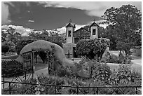 Gardens and walled courtyard, Sanctuario de Chimayo. New Mexico, USA (black and white)