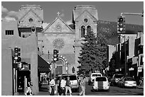 Pedestrians and street with cathedral, downtown. Santa Fe, New Mexico, USA ( black and white)