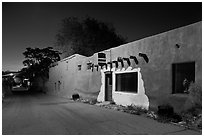 Street in Bario de Analco by night. Santa Fe, New Mexico, USA ( black and white)
