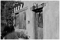 Door, window, and vigas (wooden beams). Santa Fe, New Mexico, USA (black and white)