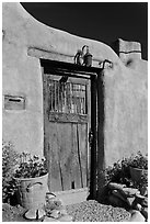 Wooden door and adobe wall. Santa Fe, New Mexico, USA ( black and white)