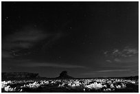 Night landscape with lighted canyon floor. Chaco Culture National Historic Park, New Mexico, USA (black and white)