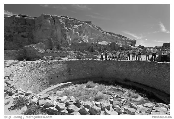 Tourists during a tour of Pueblo Bonito. Chaco Culture National Historic Park, New Mexico, USA (black and white)