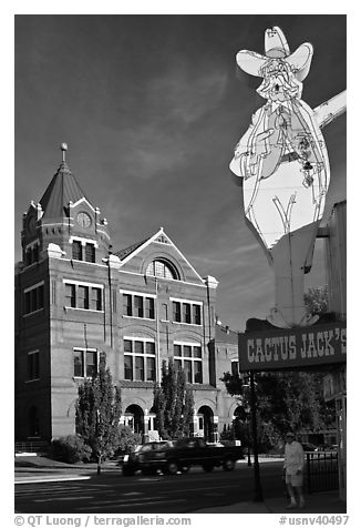Giant Cactus Jack sign and brick building. Carson City, Nevada, USA (black and white)