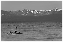 Kayak, turquoise waters and snowy mountains, East Shore, Lake Tahoe, Nevada. USA ( black and white)