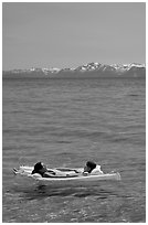 Girls laying on floating mattress, Sand Harbor, East Shore, Lake Tahoe, Nevada. USA (black and white)