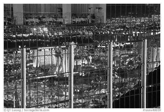 Restaurant and city reflections on glass windows, the Hotel at Mandalay Bay. Las Vegas, Nevada, USA (black and white)