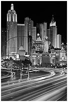 Traffic light trails and New York New York casino at night. Las Vegas, Nevada, USA (black and white)