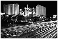 Traffic light trails and Excalibur casino at night. Las Vegas, Nevada, USA (black and white)