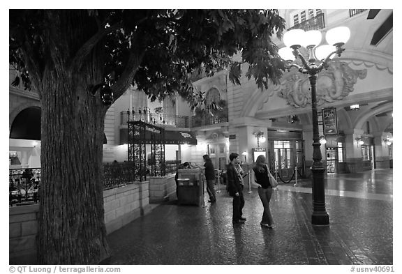 black and white picture photo man and woman standing on plaza