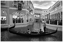 Family gondola ride inside Venetian casino. Las Vegas, Nevada, USA ( black and white)