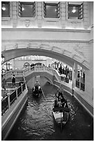 Couple kissing in gondola below bridge, Venetian casino. Las Vegas, Nevada, USA (black and white)