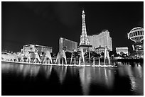Paris casino and Bellagio fountains by night. Las Vegas, Nevada, USA (black and white)