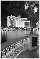 Lamp, reflection lake, and Bellagio hotel at night. Las Vegas, Nevada, USA ( black and white)