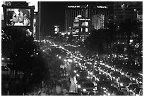 Congested foot and car traffic on Las Vegas Boulevard on Saturday night. Las Vegas, Nevada, USA (black and white)