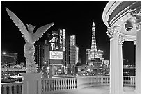 Gazebo and statue of Caesar Palace frames Ballys and Paris Hotel. Las Vegas, Nevada, USA (black and white)