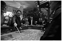 Dealer collecting during Craps game. Las Vegas, Nevada, USA ( black and white)