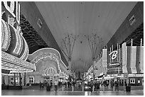 Pedestrian, canopy-covered section of Fremont Street. Las Vegas, Nevada, USA (black and white)