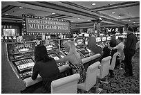 Gambling with gaming  machines. Las Vegas, Nevada, USA (black and white)