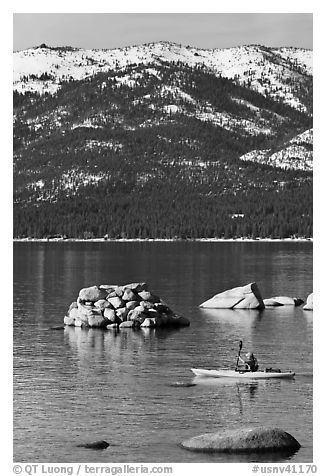 Kayaker with backdrop of snow-covered mountains, Lake Tahoe-Nevada State Park, Nevada. USA (black and white)
