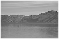 Kayak in the distance and mountains in winter, Lake Tahoe, Nevada. USA ( black and white)