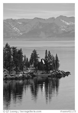 Cabin on lakeshore and snowy mountains, Lake Tahoe, Nevada. USA (black and white)