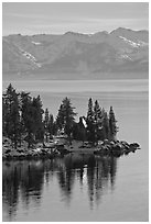 Cabin on lakeshore and snowy mountains, Lake Tahoe, Nevada. USA ( black and white)