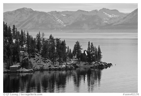 Lakeshore with houses and snow-covered mountains, Lake Tahoe, Nevada. USA (black and white)