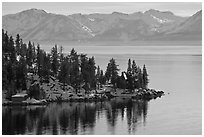 Lakeshore with houses and snow-covered mountains, Lake Tahoe, Nevada. USA ( black and white)