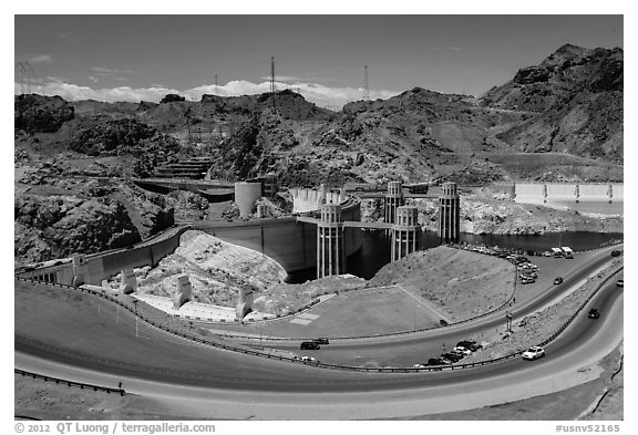 Dam with US 93 route traffic prior to bypass. Hoover Dam, Nevada and Arizona (black and white)