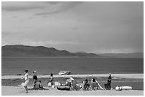 Lakeshore beach recreation, approaching storm. Pyramid Lake, Nevada, USA ( black and white)