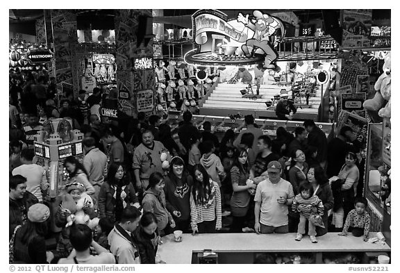 Families crowd arcade during holidays. Reno, Nevada, USA (black and white)
