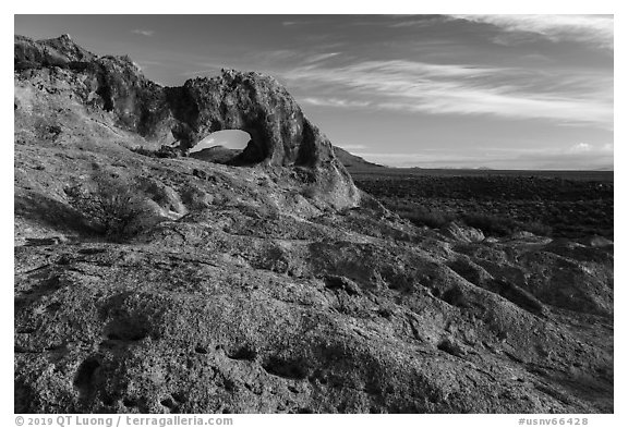 Slab and natural arch, early morning. Basin And Range National Monument, Nevada, USA (black and white)