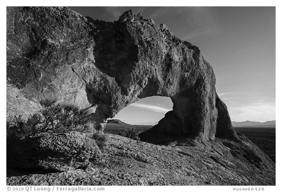 Natural arch through volcanic rock. Basin And Range National Monument, Nevada, USA (black and white)
