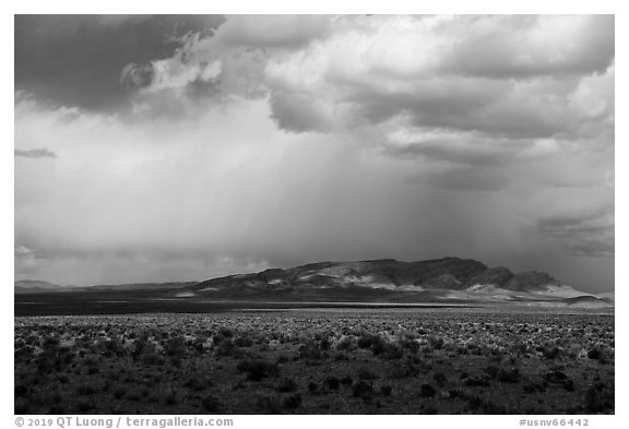Wide valley, distant mountains, and clouds. Basin And Range National Monument, Nevada, USA (black and white)