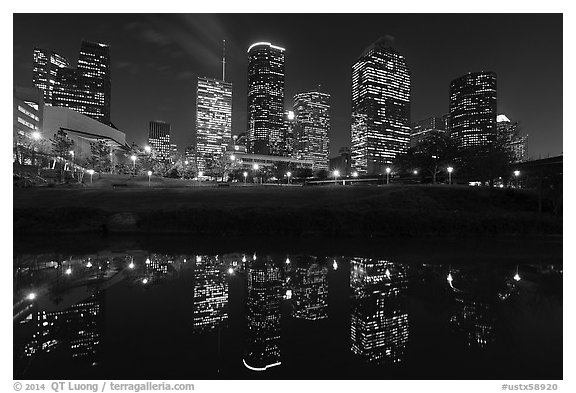 Dowtown skyline and reflection at night. Houston, Texas, USA (black and white)