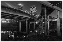 Skyline from under highway bridges at night. Houston, Texas, USA ( black and white)
