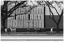 Children strolling in front of Museum of Fine Arts. Houston, Texas, USA ( black and white)