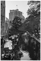 Riverwalk promenade, approaching barge. San Antonio, Texas, USA ( black and white)