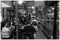 Enjoying drinks on Riverwalk. San Antonio, Texas, USA ( black and white)